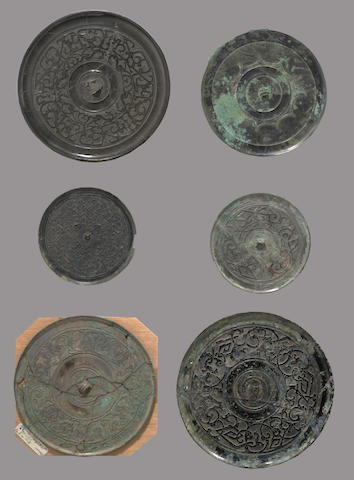 A group of six archaic bronze mirrors Warring States to Western Han dynasty
