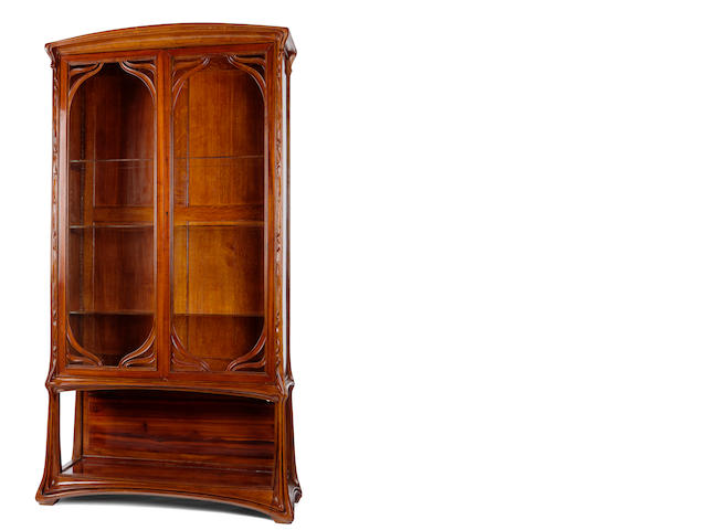 An Art Nouveau Ecole de Nancy carved mahogany cabinet circa 1900