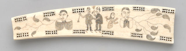 An Eskimo ivory cribbage board