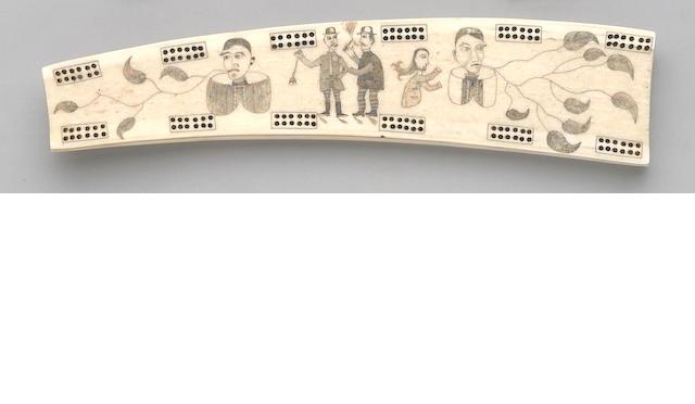 An Eskimo ivory cribbage board