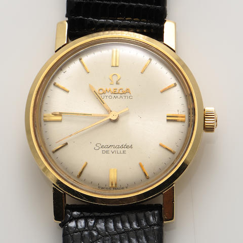 An 14k gold strap wristwatch, Omega