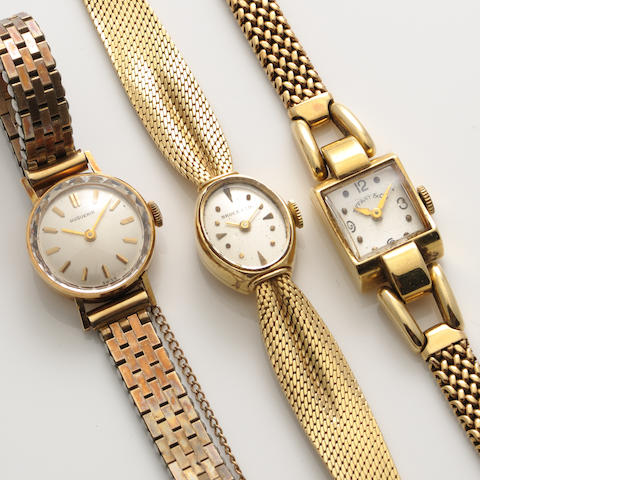 A collection of three gold bracelet wristwatches, one with metal bracelet