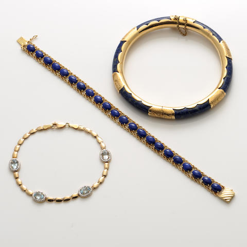 A collection of lapis lazuli, topaz and gold jewelry