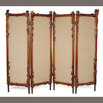 An Art Nouveau foliate carved-mahogany four-panel screen probably Ecole de Nancy, circa 1900