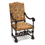 A Baroque style needlepoint upholstered armchair