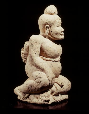 A tuff seated male Java, Majapahit period, 14th-16th century