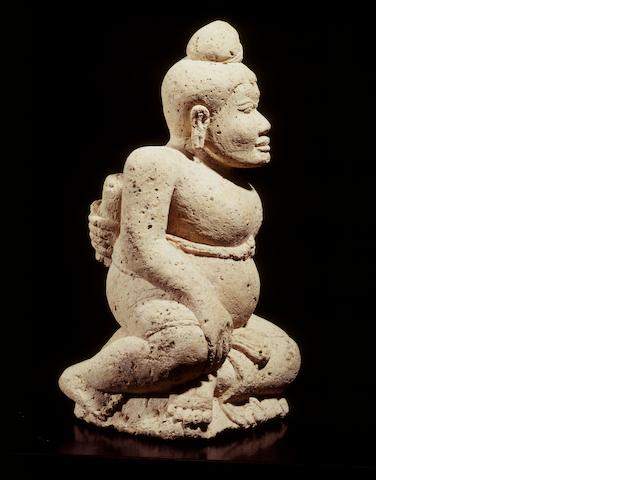 A tuff seated male Java, Majapahit period 14th-16th century