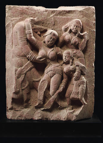 A mottled red sandstone relief of a Bacchanalian scene India, Mathura, Kushan period, 2nd century