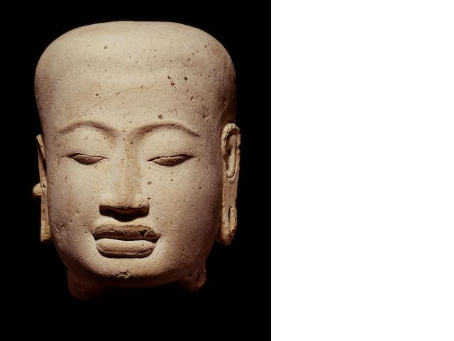 A terracotta head of a deity Java, Majapahit period,14th-16th century