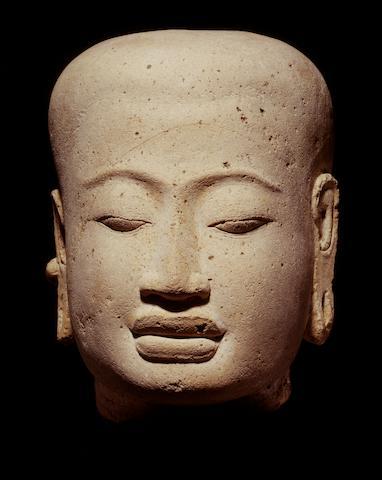 A terracotta head of a deity Java, Majapahit period,14th-16th century