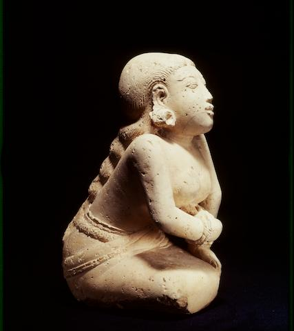 A tuff kneeling woman Majapahit period,14th-16th century