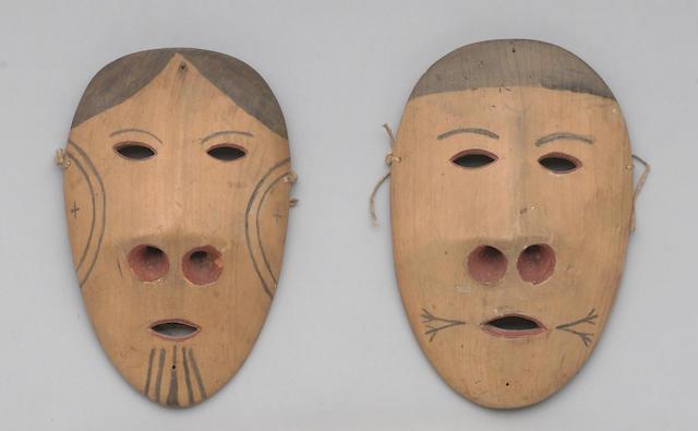 A pair of Eskimo masks