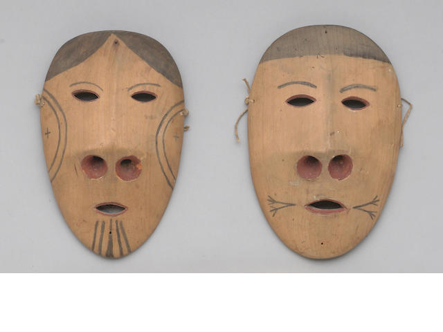 A pair of Eskimo masks