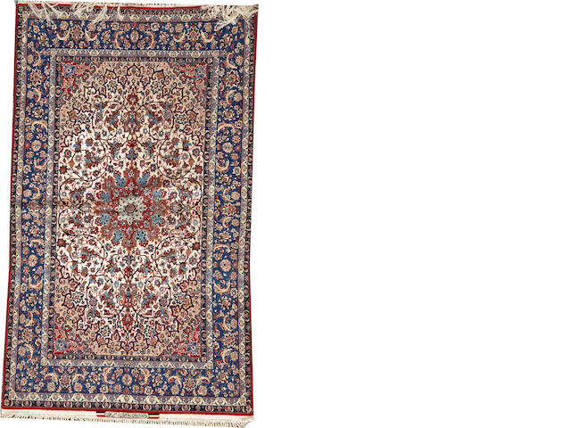 An Isphahan carpet size approximately 4ft. 10in. x 8ft. 1in.