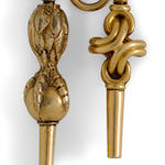 A gold watch fob and two gold keysMid 19th century