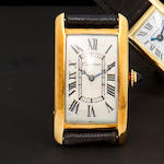 "Cartier. A fine and rare 18K gold Tank Cintrée wristwatchCase no. 22990 / 27313, ref 4176, case with French guarantee mark, by European Watch and Clock Co.,1930's, engraved in cursive script ""Damon Runyon / New York American"""