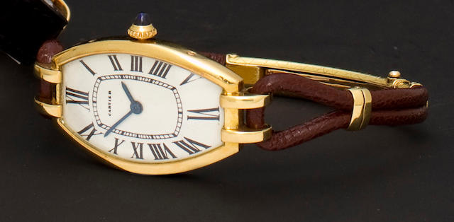 Cartier. An 18K gold tonneau wristwatchRef: 24794, Case No. 17173, Movement No. 1760647