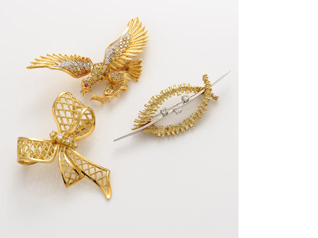 A collection of three diamond, colored diamond and bicolor gold brooches