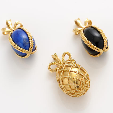 """A group of three 18k gold and hardstone """"egg"""" pendants,"""