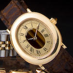 Breguet. An 18K gold and tiger's eye lady's wristwatch Ref: BA 8011, Case No.2058, sold 1988