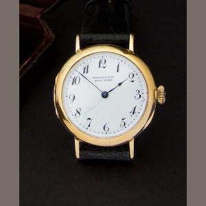 Patek Philippe. A rare 18K gold early wristwatchSigned Tiffany & Co, New York, no. 103725, circa 1915