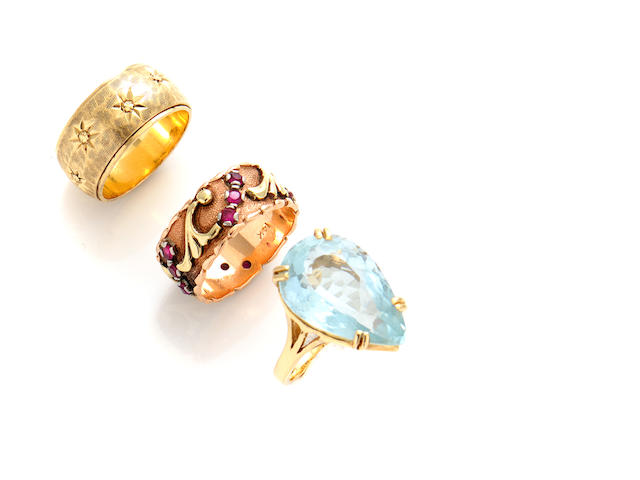 A group of four diamond, aquamarine, red stone and gold rings