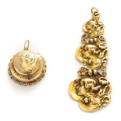 A group of two art noveau style gold pendants