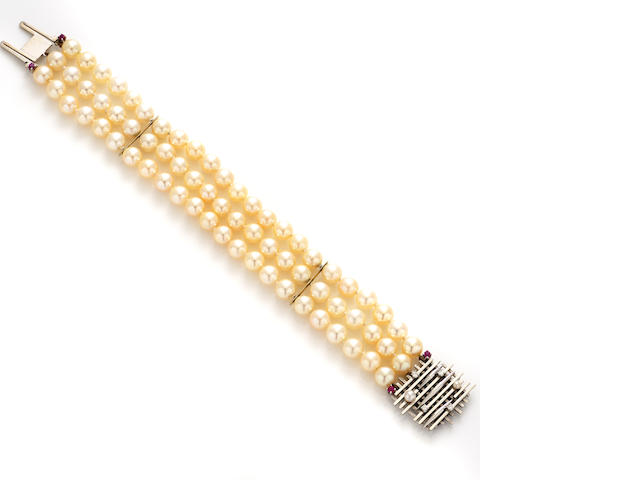 A cultured pearl, diamond, ruby and white gold triple strand bracelet
