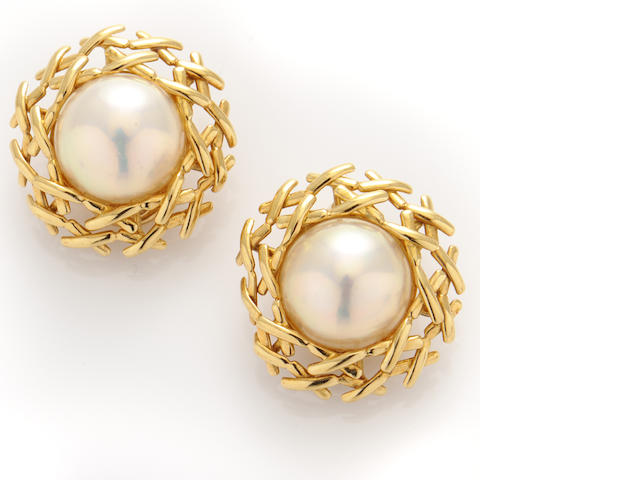 A pair of mabe pearl and 18k gold earrings,