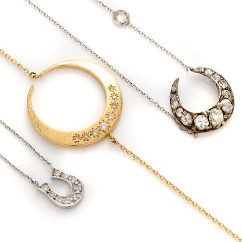 A group of three diamond and gold pendant necklaces