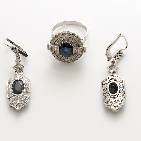 A sapphire, diamond, white gold ring and pendant earring set