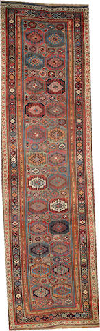 A Kurdish runner size approximately 7ft. 6in. x 13ft. 8in.