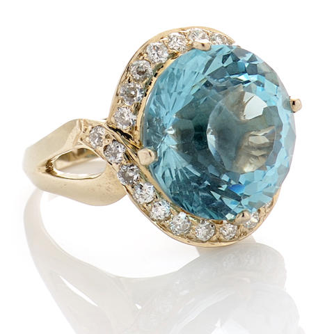 An aquamarine, diamond and 14k white gold ring