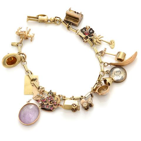 A gem-set, enamel and gold charm bracelet