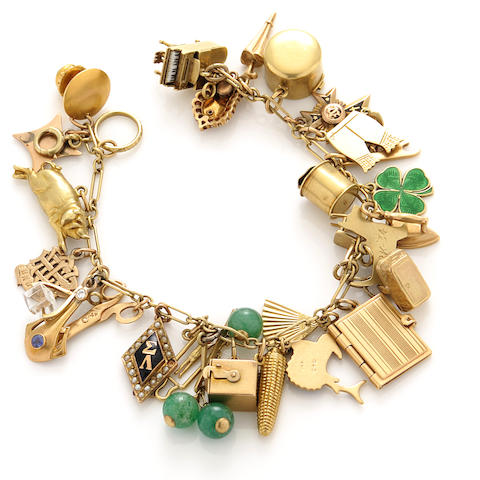 A gem-set, enamel and gold charm bracelet