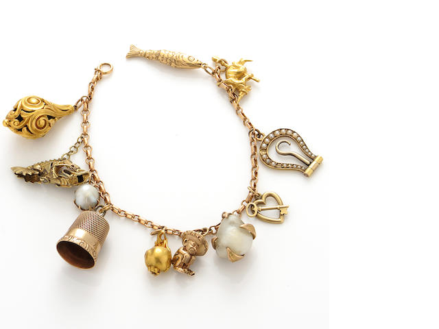 A cultured pearl and gold charm bracelet