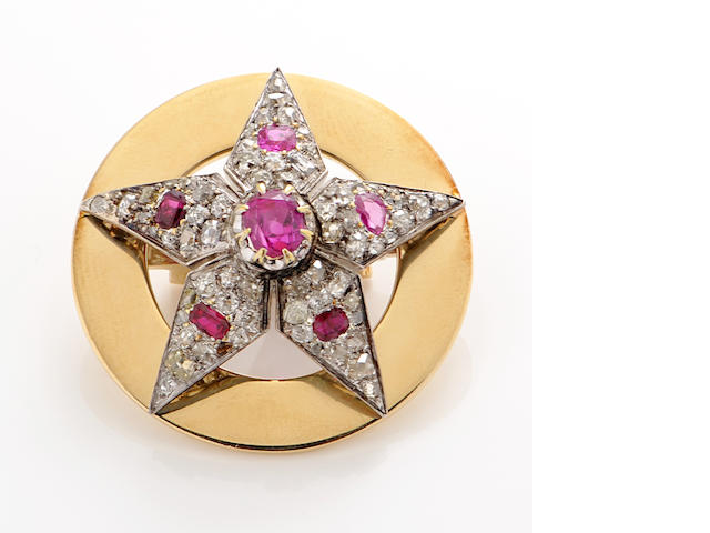 A diamond, ruby and 14k gold star motif circle brooch