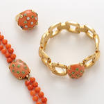 A collection of coral, diamond, peridot and gold jewelry