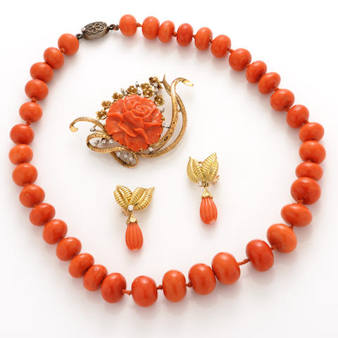 A group of coral, 14k gold and silver jewelry