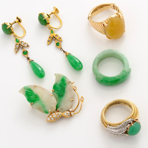 A collection of multi-colored jade, nephrite, diamond and gold jewelry