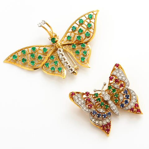A group of two diamond, sapphire, ruby, emerald and bicolor gold butterfly brooches