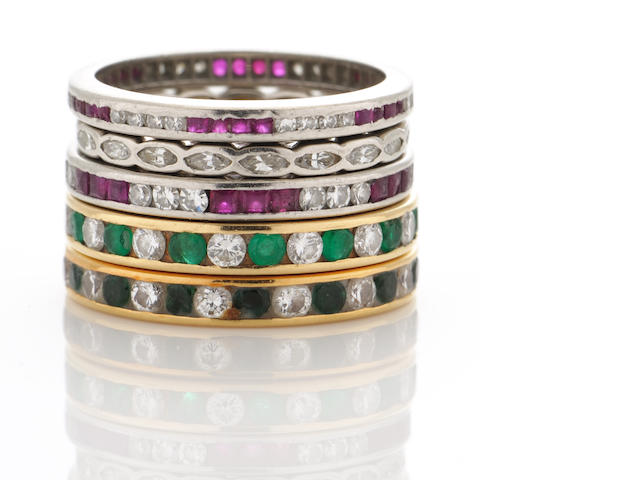 A group of five diamond, emerald, ruby, platinum and gold bands