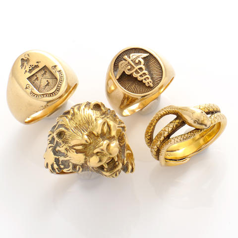 A group of four men's gold rings