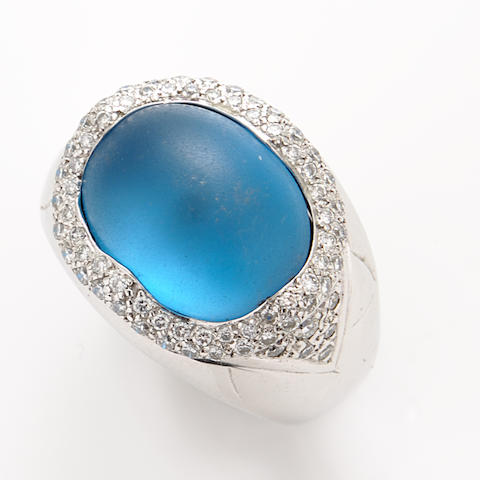 A frosted blue topaz, diamond and white gold ring