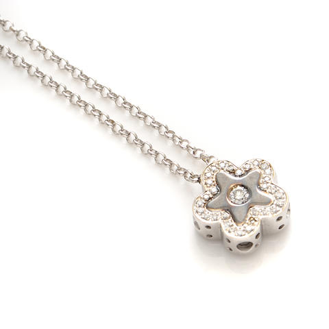 A diamond and 18k white gold star motif pendant and chain