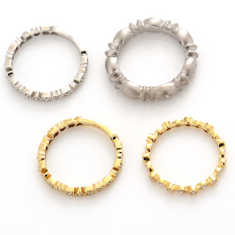 A collection of four diamond and gold rings