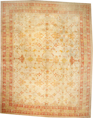 An Oushak carpet  West Anatolia size approximately 13ft. 2in. x 16ft. 8in.