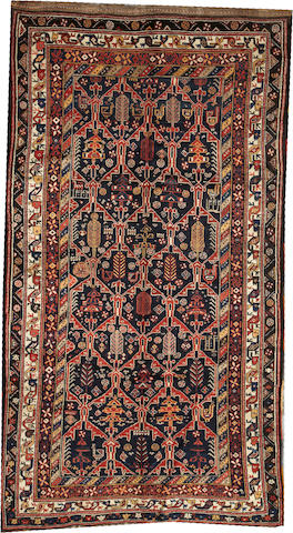 A Bakhtiari carpet  Southwest Persia size approximately 5ft. 3in. x 9ft. 6in.