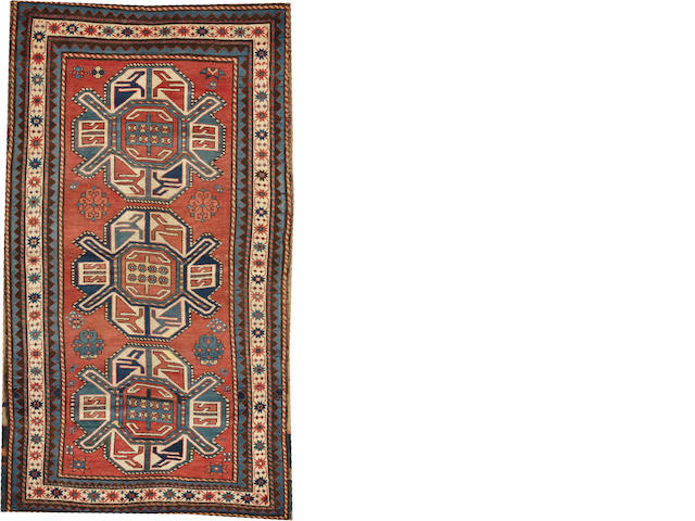 A Kazak rug  Caucasus size approximately 4ft. 2in. x 7ft. 4in.