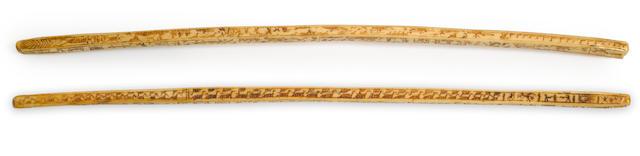 An Eskimo scrimshaw ivory bow drill